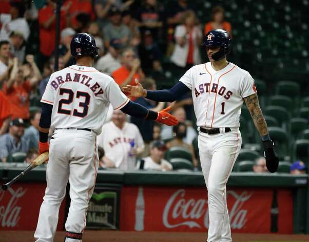 Houston Astros Carlos Correa scores a run as Jason Castro walked with the bases loaded to take the lead during the eighth inning of an MLB baseball game at Minute Maid Park, Wednesday, April 28, 2021, in Houston. Photo: Karen Warren, Staff Photographer / @2021 Houston Chronicle