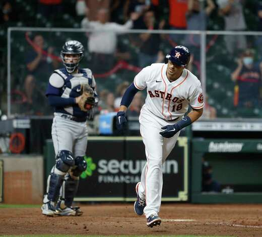 Houston Astros Jason Castro (18) walks with the bases loaded allowing Carlos Correa to score a run during the eighth inning of an MLB baseball game at Minute Maid Park, Wednesday, April 28, 2021, in Houston. Photo: Karen Warren, Staff Photographer / @2021 Houston Chronicle