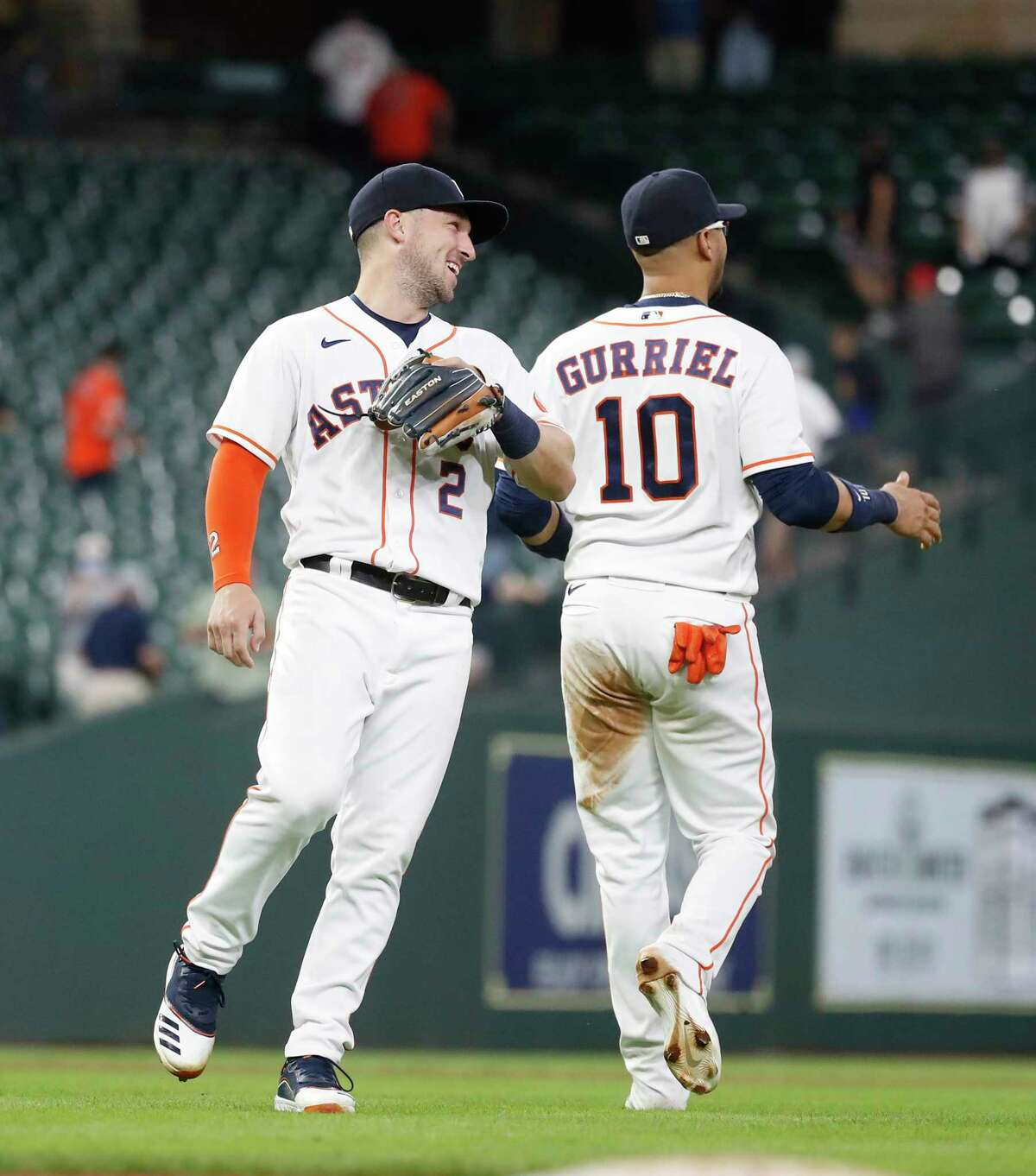 Houston Astros Alex Bregman (2) celebrates with Yuli Gurriel (10) after Seattle Mariners J.P. Crawford ground out to end an MLB baseball game at Minute Maid Park, Wednesday, April 28, 2021, in Houston. Astros came from behind to beat the Seattle Mariners 7-5.