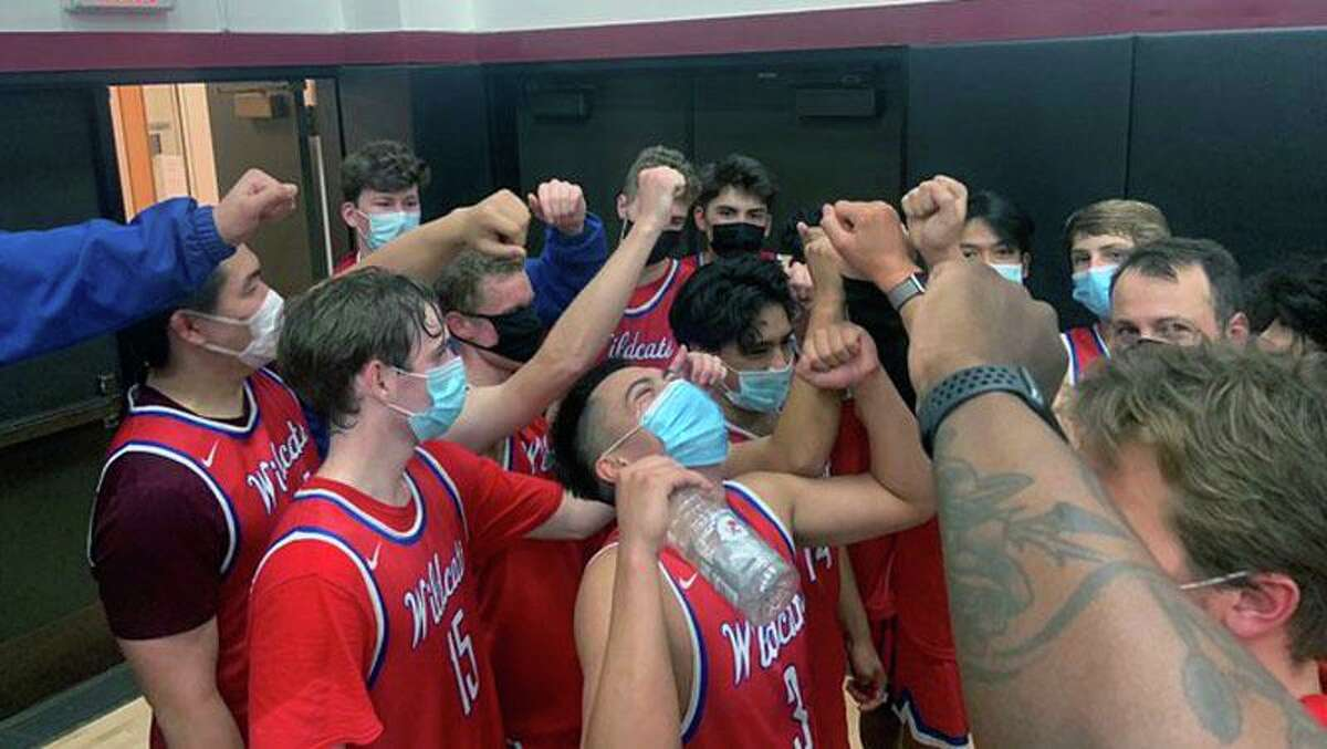 St. Ignatius players celebrate their 65-51 win over Sacred Heart Prep-Atherton on Tuesday.
