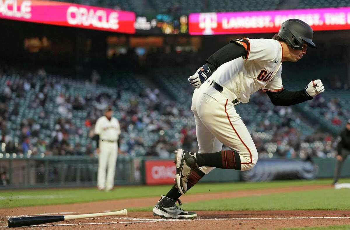 New Giants outfielder Michael Tauchman runs to first base after hitting a single against the Colorado Rockies during the fourth inning of a baseball game in San Francisco Wednesday, April 28, 2021. (AP Photo/Jeff Chiu)