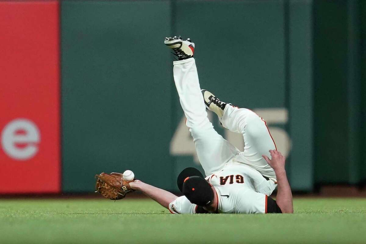 San Francisco Giants' right fielder Darin Ruf reaches for a double hit by Colorado Rockies' Garrett Hampson during the sixth inning of a baseball game in San Francisco on Wednesday, April 28, 2021. (AP Photo/Jeff Chiu)
