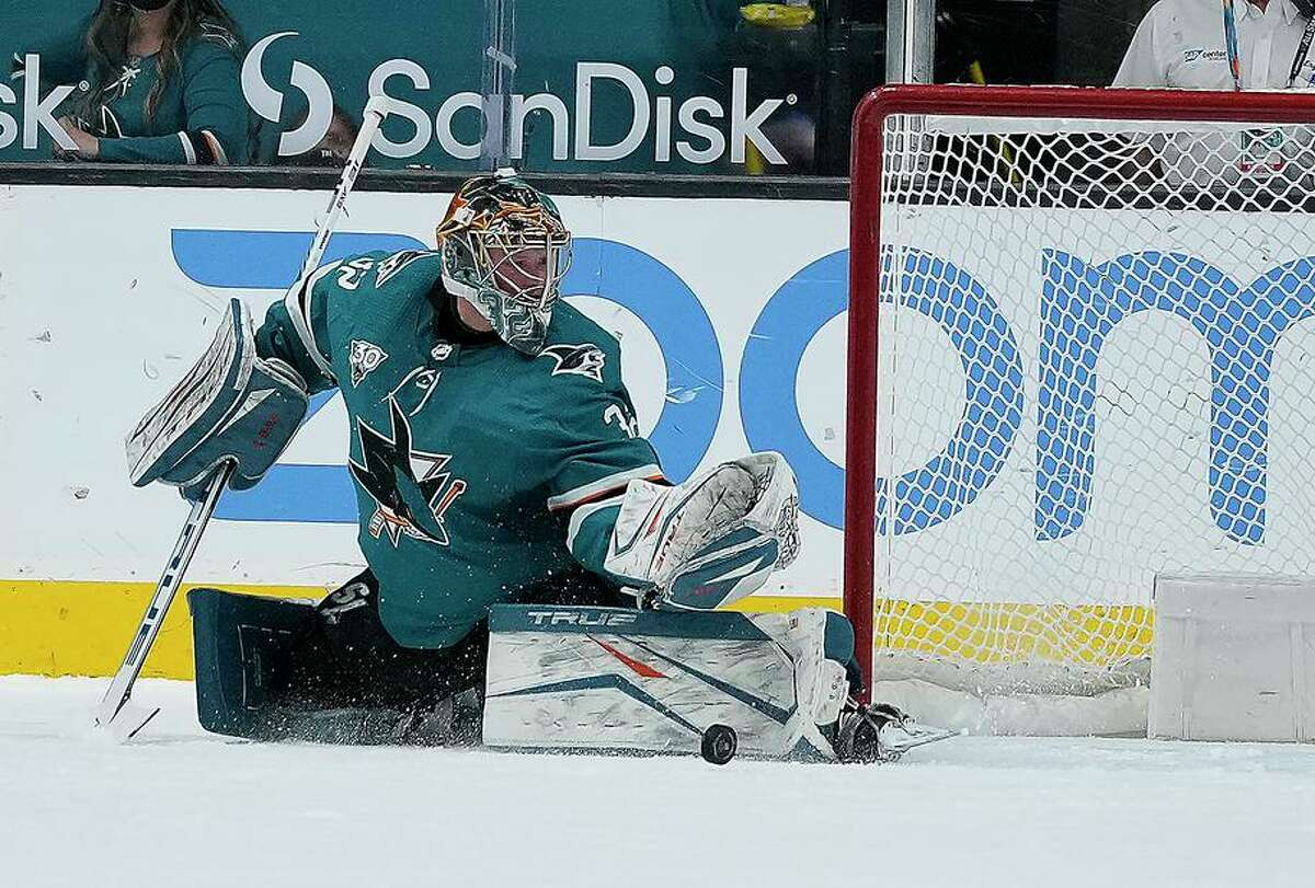 Sharks goaltender Josef Korenar turns aside a shot in the first period against the Coyotes at SAP Center.