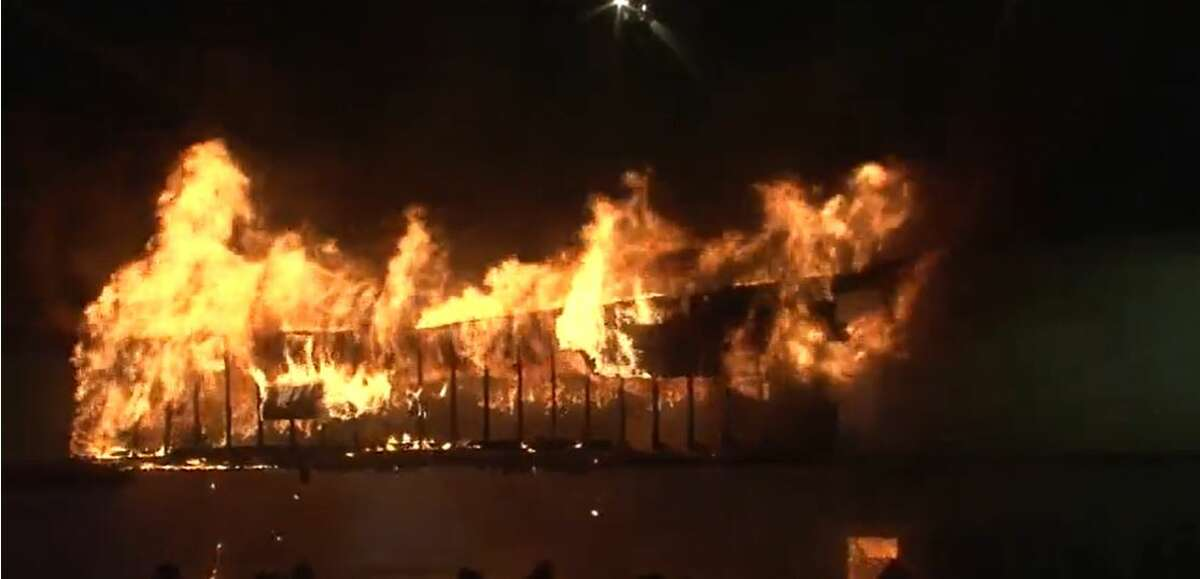 Flames broke out early Thursday at a shopping center on Jensen Drive in north Houston. Firefighters are fighting the three-alarm blaze.