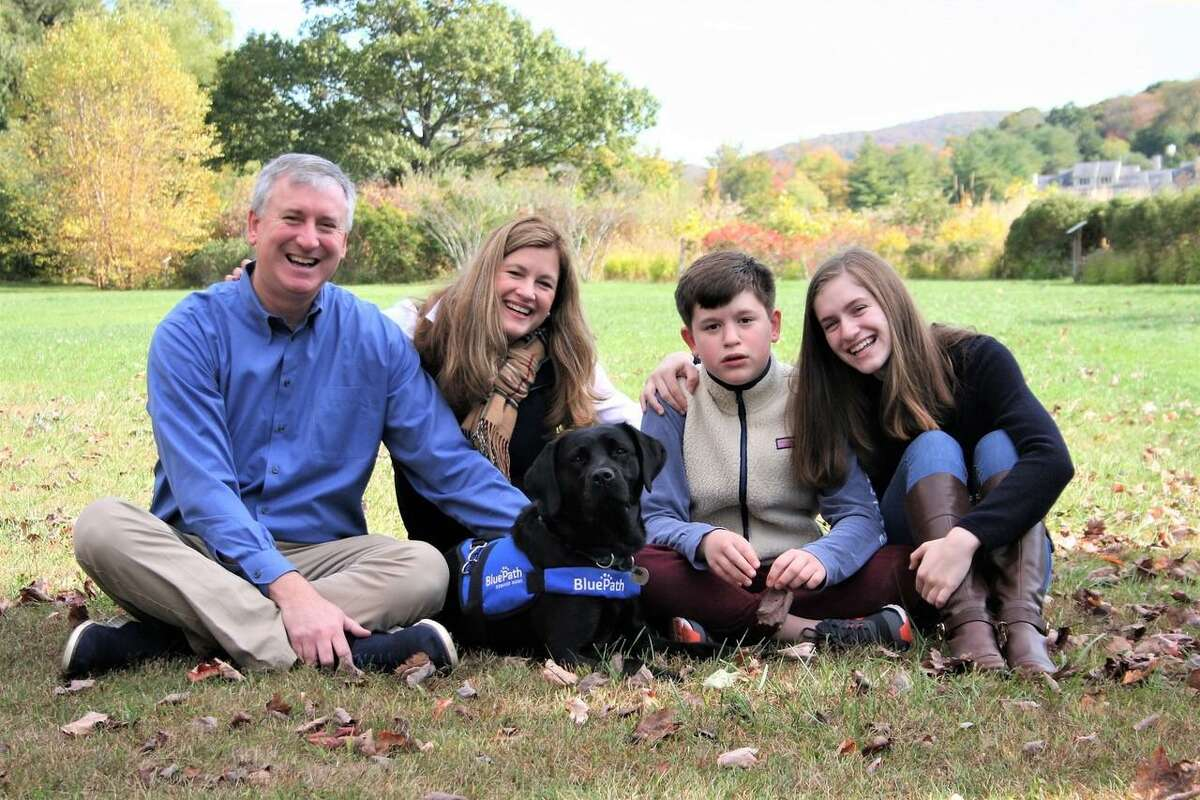 The Collins family, of Ridgefield, were matched with BluePath service dog Chelsea in 2019. The pup is specially trained to provide safety, companionship and opportunities for independence for children with autism.
