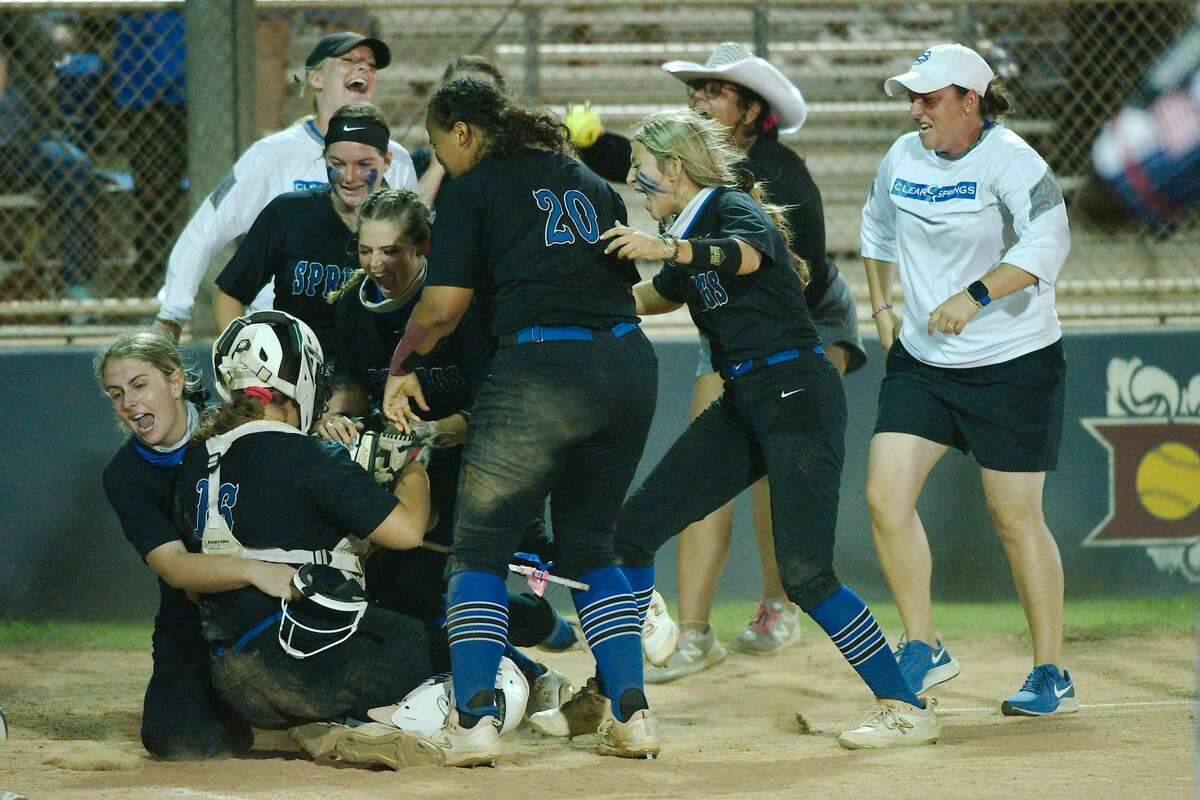 Clear Springs'Kelly Baker (16) is swarmed by teammates after making the final out to seal the victory over Dawson Wednesday, Apr. 28 at Dawson High School.
