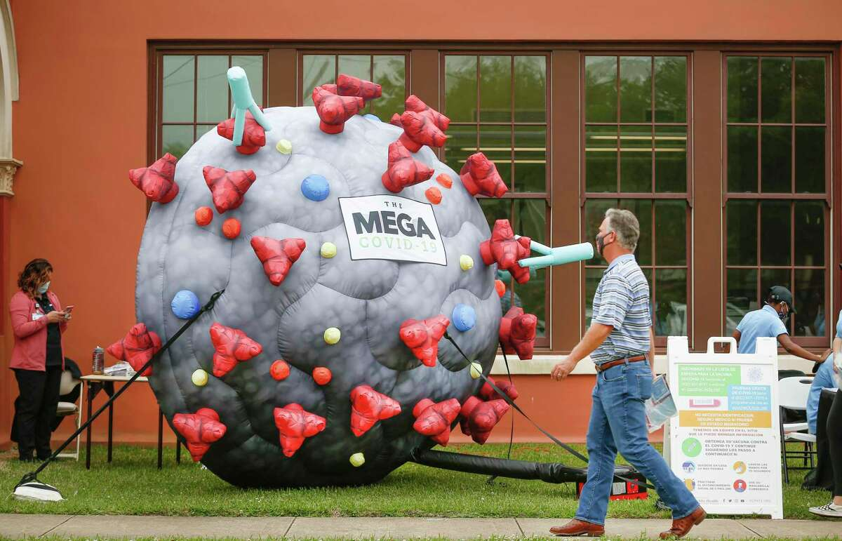 A large COVID-19 inflatable encouraged people to attend a Precinct 2 vaccine event April 27 at Leonel Castillo Community Center.