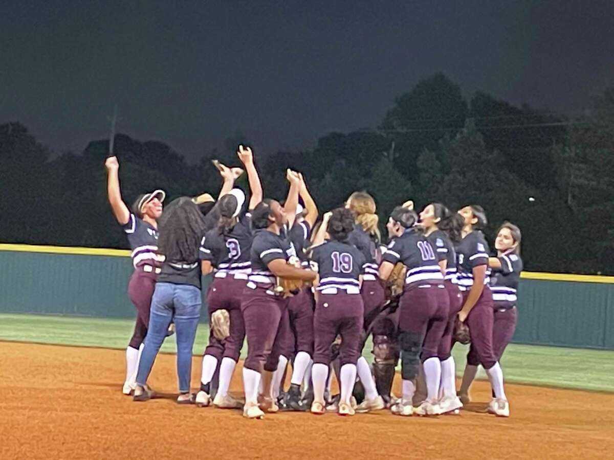 The Heights softball team celebrates after beating Stratford 10-4 on April 28 at Stratford High School in the first round of the playoffs and advancing to the second round for the first time since the 2012 season