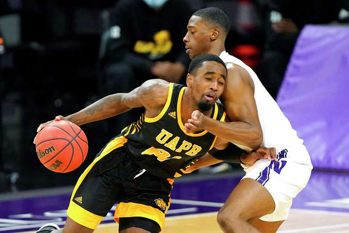 Arkansas-Pine Bluff's Shaun Doss Jr. (left) drives on Northwestern's Chase Audige Jr. during the second half a game Dec. 2 in Evanston, Illinois. Doss is transferring to SIUE for the 2021-22 season.