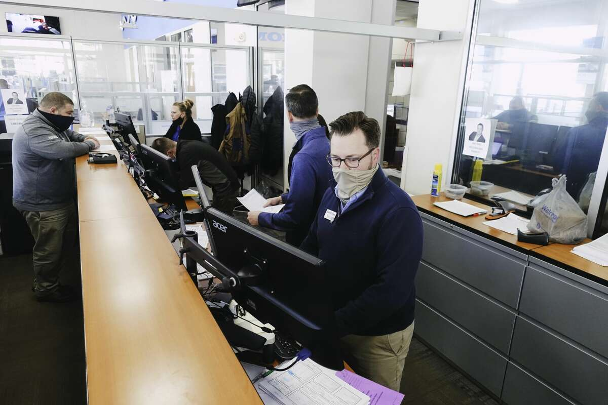 Jamison Frank, a sales manager with Mohawk Honda, works at the sales desk on Monday, April 26, 2021, in Schenectady, N.Y. (Paul Buckowski/Times Union)
