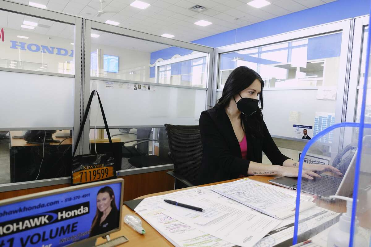 Nicole Oeser, a sales and leasing consultant with Mohawk Honda, works at her desk in the showroom on Monday, April 26, 2021, in Schenectady, N.Y. (Paul Buckowski/Times Union)