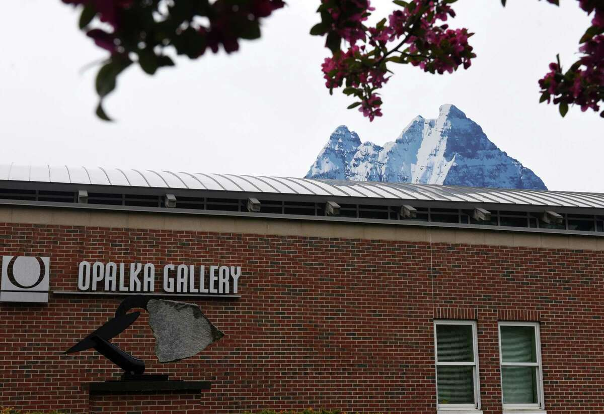 A 12-foot tall image of a snow-covered mountaintop from Albany artist Adam Frelin adds a new perspective to Opalka Gallery rooftop on Thursday, April 29, 2021, in Albany, N.Y. The installation was designed to create a trompe l'oeil illusion behind the Russell Sage College campus on New Scotland Avenue. Frelin is a sculptor and currently serves as the Associate Professor of Studio Art at University at Albany. (Will Waldron/Times Union)