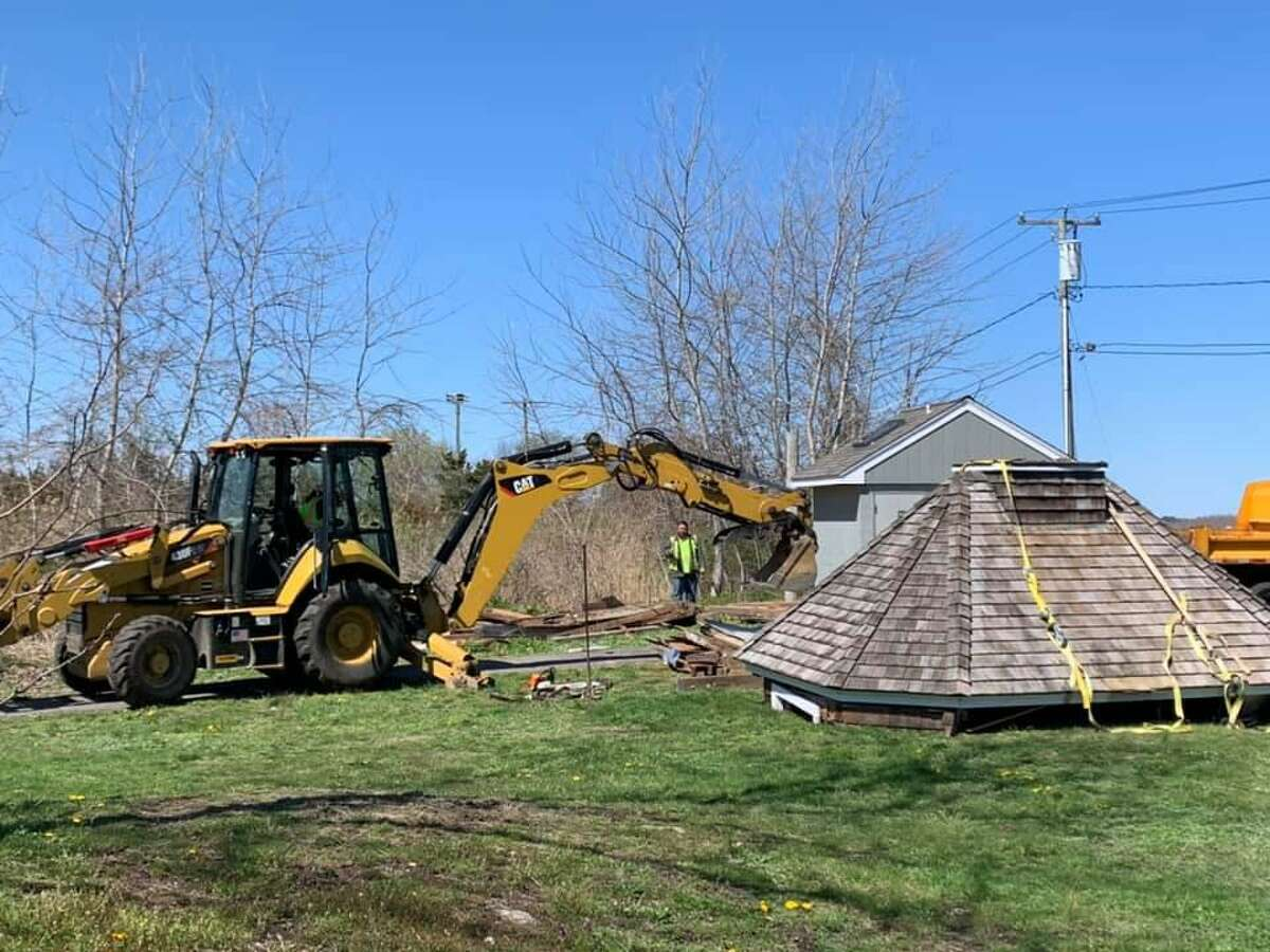 The 1935 tercentenary visitor center, built for the 300 anniversary of Saybrook Colony, was taken down by town crews on Tuesday after years without use or restoration.
