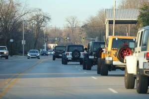 The Jeepformers Social Club's caravan makes its way through Alton in December during a social outing that also included outreach to a single mother. Each Jeepformers member — including Alton's Tammy Smith who founded A Precious Organization for Sickle Cell — participates in outreach to individuals, families and other organizations.