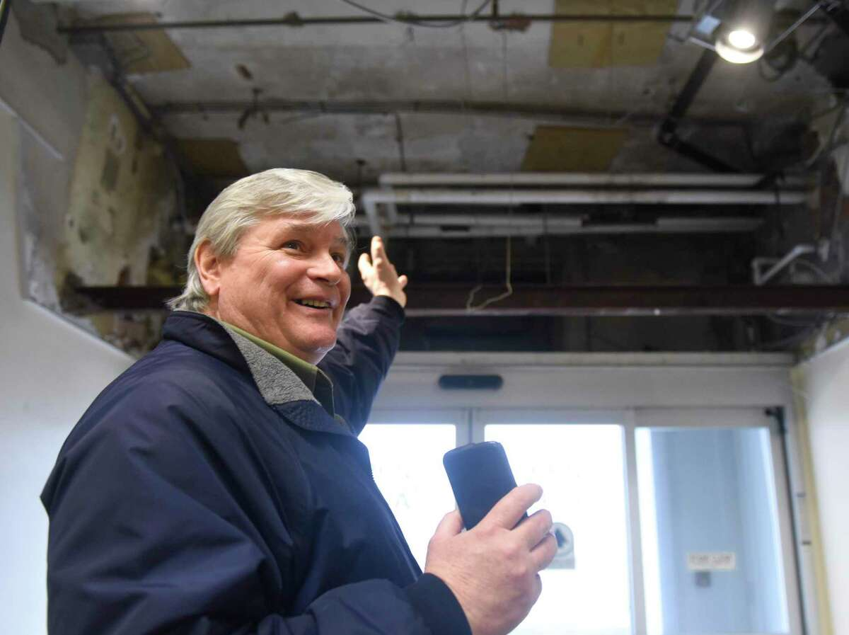 Town of Greenwich Superintendent of Building Construction & Maintenance Alan Monelli shows an entranceway that was stripped of an air conditioner to make way for a raised ceiling at the Senior Center in Greenwich, Conn. Wednesday, Feb. 26, 2020.