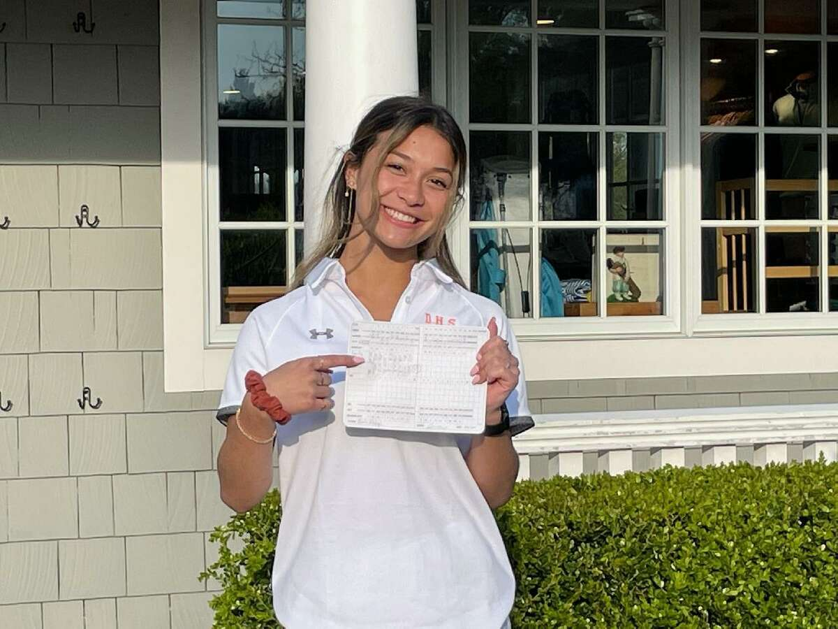 Danbury's Harley Hodge displays the scorecard at Country Club of Darien, where she made an ace on the second hole on Tuesday.