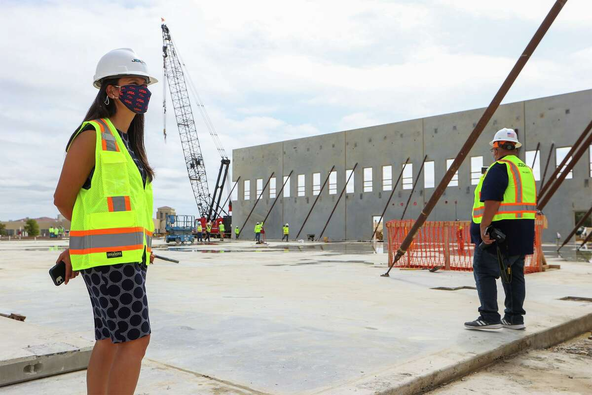 UTSA Athletic Director Lisa Campos, left, leads a construction update tour of the Roadrunner Athletics Center for Excellence in September.