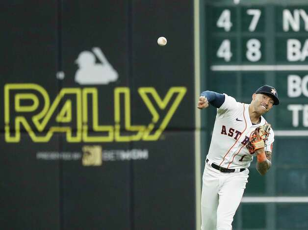 Houston Astros shortstop Carlos Correa (1) makes the throw to first base as Seattle Mariners Jose Marmolejos ground out during the first inning of an MLB baseball game at Minute Maid Park, Thursday April 29, 2021, in Houston. Photo: Karen Warren, Staff Photographer / @2021 Houston Chronicle