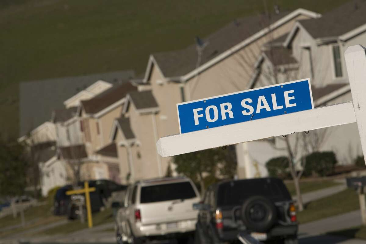 """A """"for sale"""" sign is seen on a single family in Vallejo, Calif., in this file photo."""