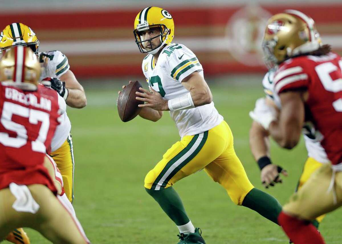 Green Bay Packers' Aaron Rodgers rolls out in 2nd quarter against San Francisco 49ers during NFL game at Levi's Stadium in Santa Clara, Calif., on Thursday, November 5, 2020.