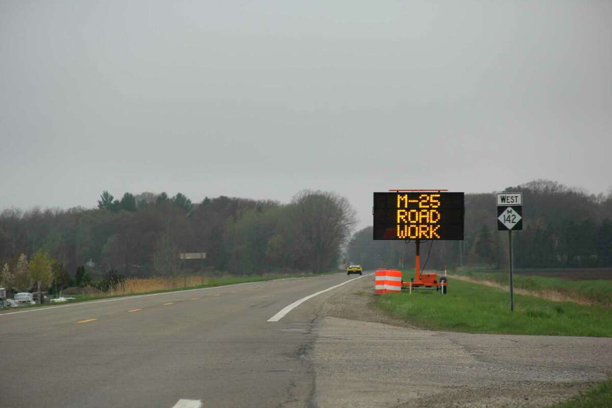 A sign warns motorists on a section of M-142 west of Pigeon where road work will take place in a few weeks. M-142 and M-25 are expected to undergo resurfacing work from May 10 through August. (Robert Creenan/Huron Daily Tribune)