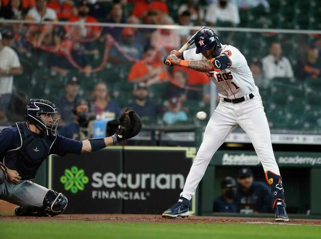 Houston Astros shortstop Carlos Correa (1) jumps back from a pitch inside from Seattle Mariners starting pitcher Yusei Kikuchi during the first inning of an MLB baseball game at Minute Maid Park, Thursday April 29, 2021, in Houston. Photo: Karen Warren, Staff Photographer / @2021 Houston Chronicle