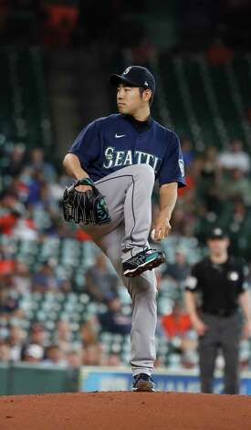 Seattle Mariners starting pitcher Yusei Kikuchi (18) pitches during the first inning of an MLB baseball game at Minute Maid Park, Thursday April 29, 2021, in Houston. Photo: Karen Warren, Staff Photographer / @2021 Houston Chronicle