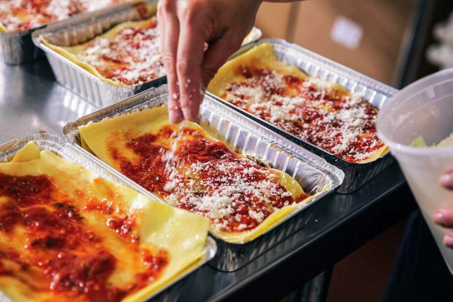 Christina Marinucci, an alumnus of Mister Jiu's, is the founder of Marinucci's Pasta Shop. She assembles lasagna at Eclectic Cookery in S.F. Photo: Stephen Lam / The Chronicle / San Francisoc Chronicle