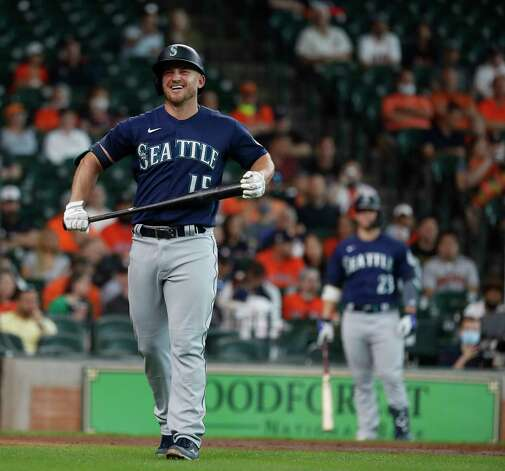 Seattle Mariners Kyle Seager (15) reacts after fouling a ball off of his leg during his at bat against Houston Astros starting pitcher Luis Garcia during the third inning of an MLB baseball game at Minute Maid Park, Thursday April 29, 2021, in Houston. Photo: Karen Warren, Staff Photographer / @2021 Houston Chronicle