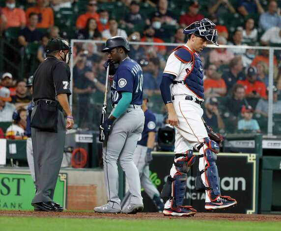 Seattle Mariners Taylor Trammell (20) argues with home plate umpire Alfonso Marquez (72) after striking out during the fifth inning of an MLB baseball game at Minute Maid Park, Thursday April 29, 2021, in Houston. Photo: Karen Warren, Staff Photographer / @2021 Houston Chronicle