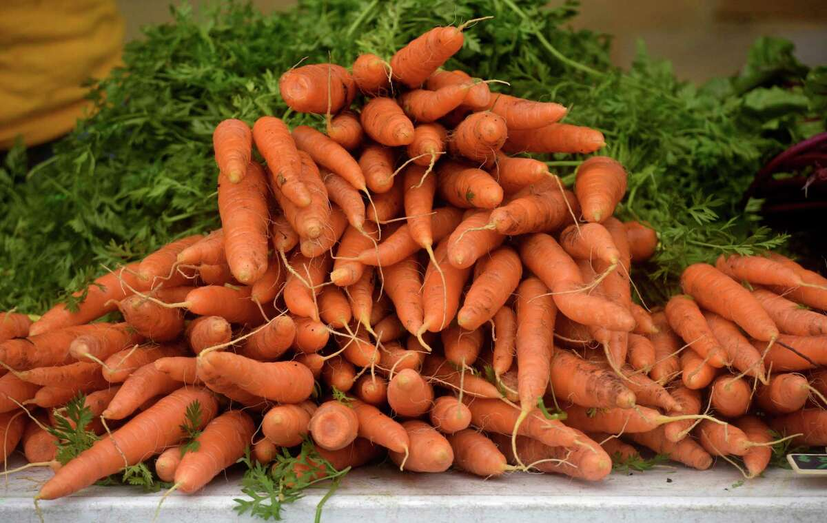 Carrots from Clatter Valley Farm, in New Milford, on display at the CityCenter Danbury Farmer's Market at the Danbury Railway Museum, Friday morning, October 23, 2020, in Danbury, Conn.