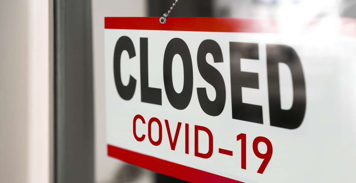 Closed businesses for COVID-19 pandemic outbreak, closure sign on retail store window banner background.