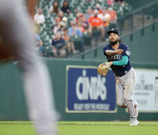 Seattle Mariners shortstop J.P. Crawford (3) throws to first base as Houston Astros lAledmys Diaz ground out during the seventh inning of an MLB baseball game at Minute Maid Park, Thursday April 29, 2021, in Houston. Photo: Karen Warren, Staff Photographer / @2021 Houston Chronicle