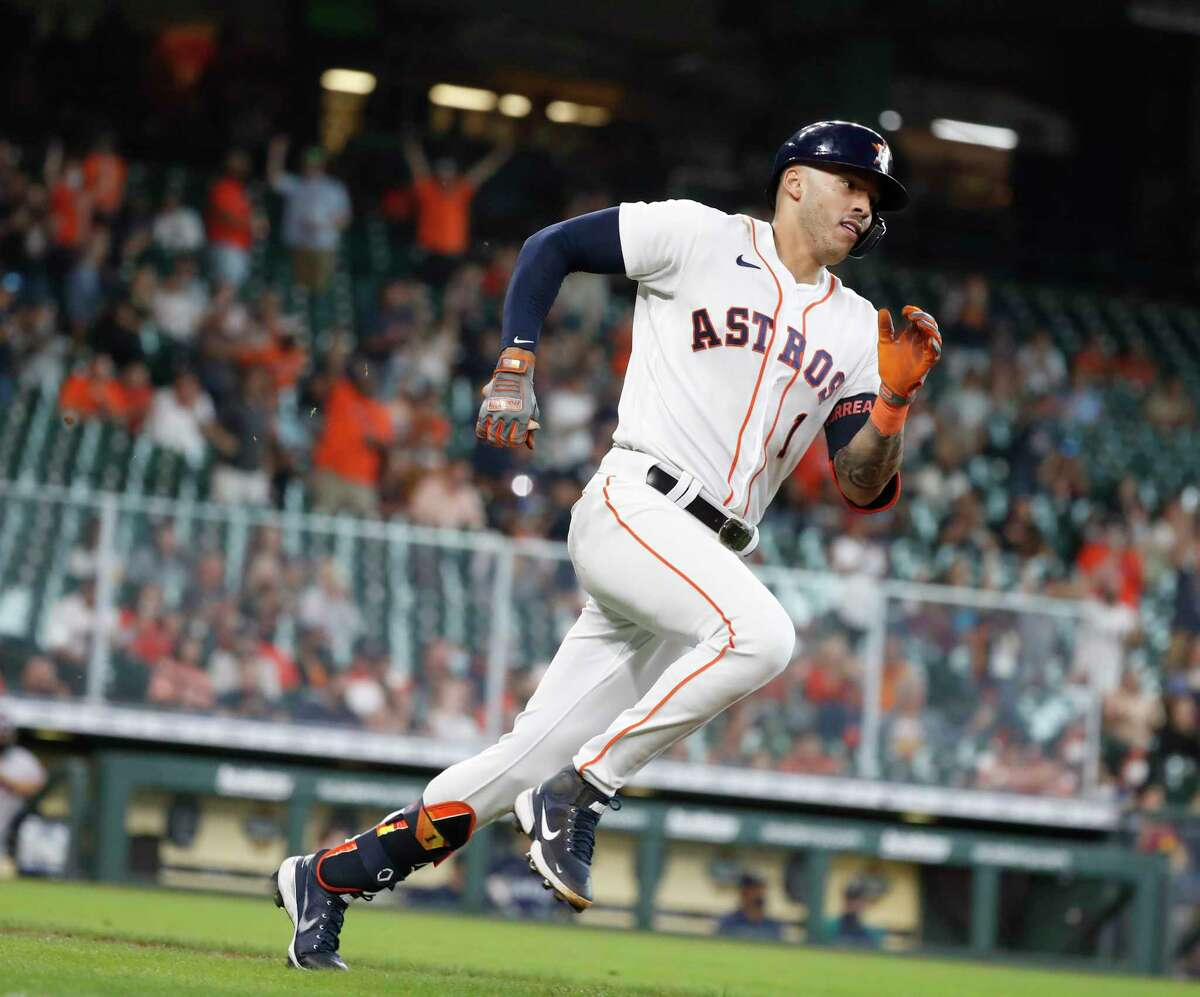 Houston Astros Carlos Correa (1) runs up the line after hitting a double, the first hit of the day, to break up Seattle Mariners starting pitcher Yusei Kikuchi's no hit bid during the seventh inning of an MLB baseball game at Minute Maid Park, Thursday April 29, 2021, in Houston.
