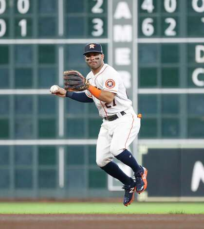 Houston Astros second baseman Jose Altuve (27) fields Seattle Mariners Evan White's ground ball out during the seventh inning of an MLB baseball game at Minute Maid Park, Thursday April 29, 2021, in Houston. Photo: Karen Warren, Staff Photographer / @2021 Houston Chronicle