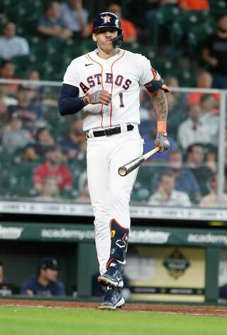 Houston Astros Carlos Correa (1) reacts after fouling a ball off his leg as he faced Seattle Mariners starting pitcher Yusei Kikuchi during the seventh inning of an MLB baseball game at Minute Maid Park, Thursday April 29, 2021, in Houston. Photo: Karen Warren, Staff Photographer / @2021 Houston Chronicle
