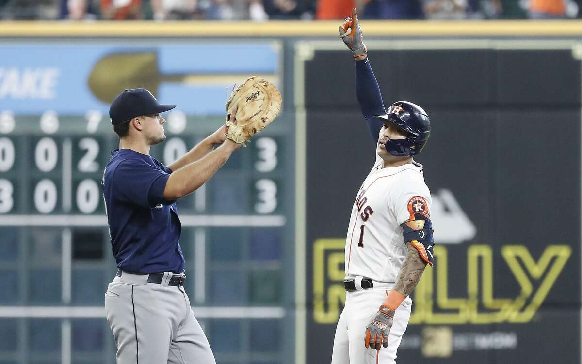 Houston Astros Carlos Correa (1) reacts at second base after his double, the first hit of the day, to break up Seattle Mariners starting pitcher Yusei Kikuchi's no hit bid during the seventh inning of an MLB baseball game at Minute Maid Park, Thursday April 29, 2021, in Houston.