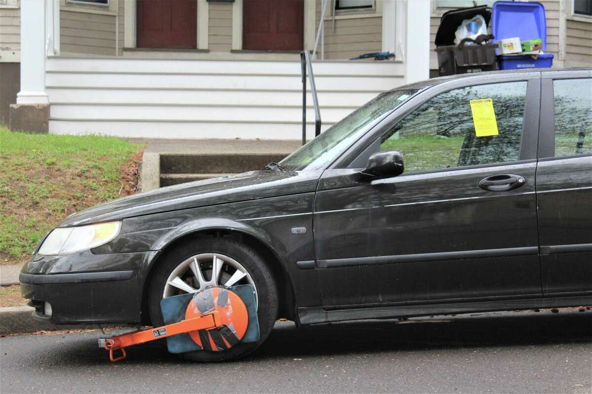 A car booted for delinquent parking tickets Thursday in Middletown.