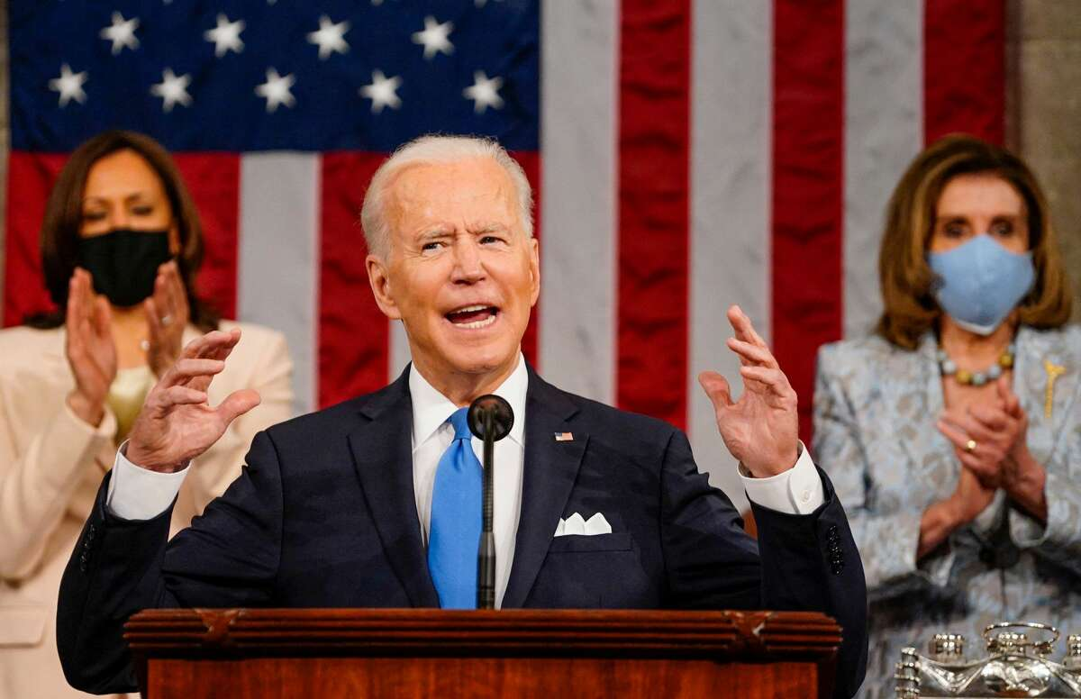 US President Joe Biden addresses a joint session of Congress as US Vice President Kamala Harris and US Speaker of the House Nancy Pelosi applaud at the US Capitol in Washington, DC, on April 28, 2021. (Photo by Melina Mara / POOL / AFP) (Photo by MELINA MARA/POOL/AFP via Getty Images)