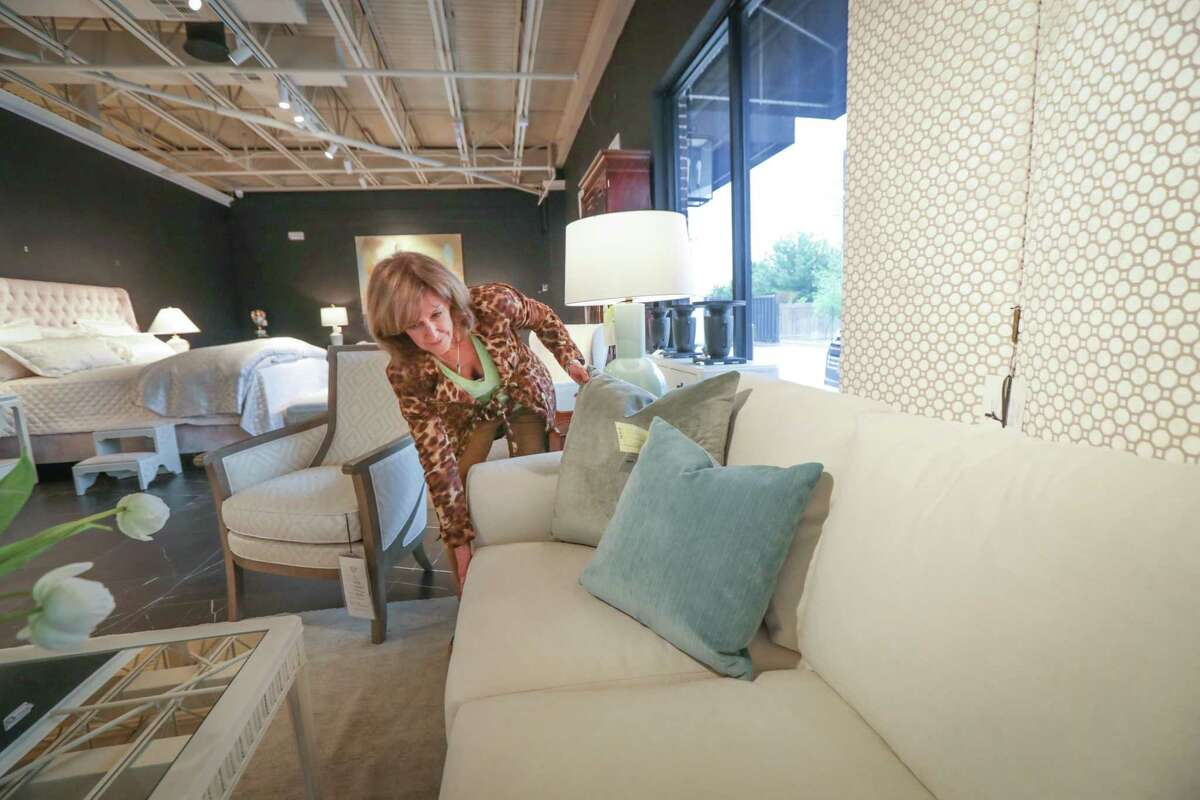 Meredith O'Donnell Fine Furniture Designer Christine Smith styles furniture in the showroom Friday, April 23, 2021, in Houston.