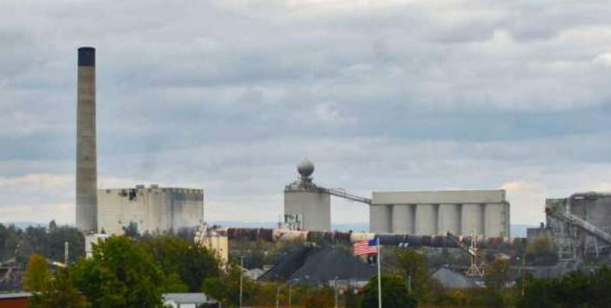 Ravena's LaFargeHolcin cement plant has reached a settlement with authorities over pollution allegations.