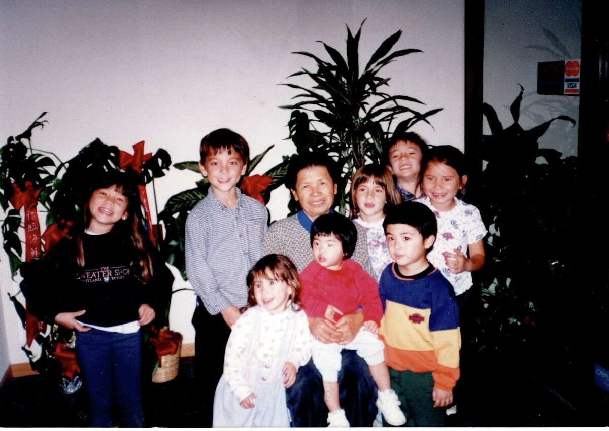 The author's mother, Shue Mok, gathering with the grandchildren, Woodland in the 1990s.