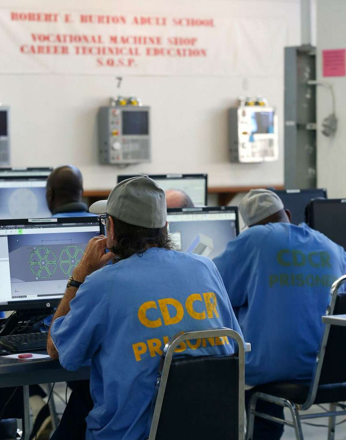 """Inmate students use computers in a vocational machine shop class of the Robert E. Burton Adult School at San Quentin State Prison in San Quentin, Calif. on Thursday, Sept. 12, 2019. Burton has been designated as a """"distinguished school,"""" the first school within the California corrections system to achieve the honor."""