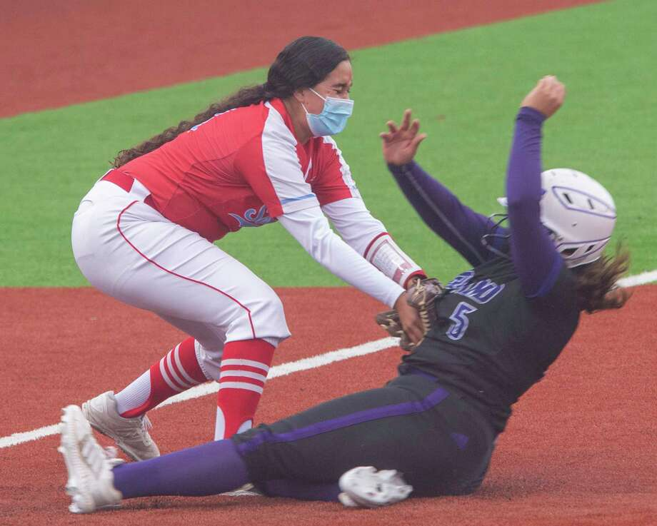 El Paso Socorro's Celeste Ortega puts the tag on Midland High's Violet Granado for an out at third 04/29/2021 at Martin Field. Tim Fischer/Reporter-Telegram Photo: Tim Fischer, Midland Reporter-Telegram