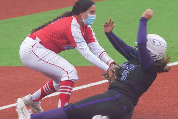 El Paso Socorro's Celeste Ortega puts the tag on Midland High's Violet Granado for an out at third 04/29/2021 at Martin Field. Tim Fischer/Reporter-Telegram