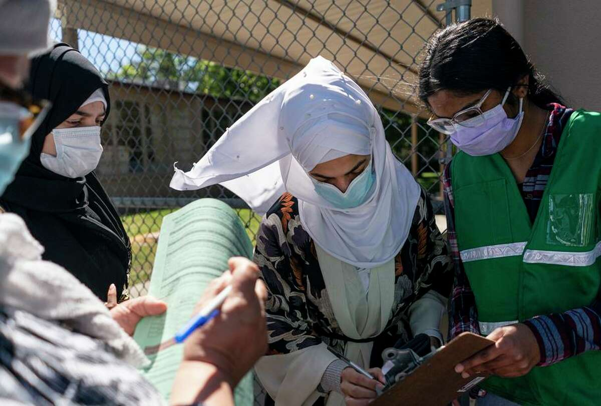 Student Anna Cheriyampurathu volunteers at the vaccine site at Vacaville High School. Youths over 16 are eligible for shots.