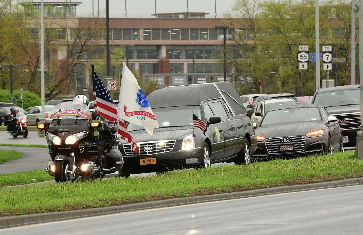 Members of the Patriot Guard Riders of New York ride in front of a hearse carrying the remains of paratrooper Abigail Jenks at the Albany International Airport on Thursday, April 29, 2021 in Albany, N.Y. The 20-year-old died in a static line jump. (Lori Van Buren/Times Union)
