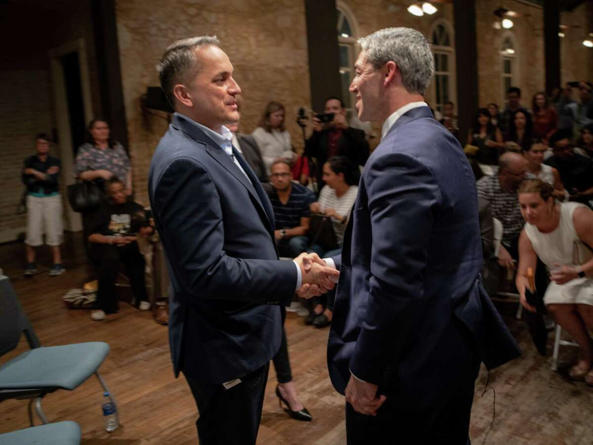 San Antonio City Councilman from District 6 Greg Brockhouse, left, shakes hands with San Antonio Mayor Ron Nirenberg, right, after a mayoral debate hosted by The Rivard Report at The Spire in St. Paul Square in San Antonio on Wednesday, April 17, 2019.