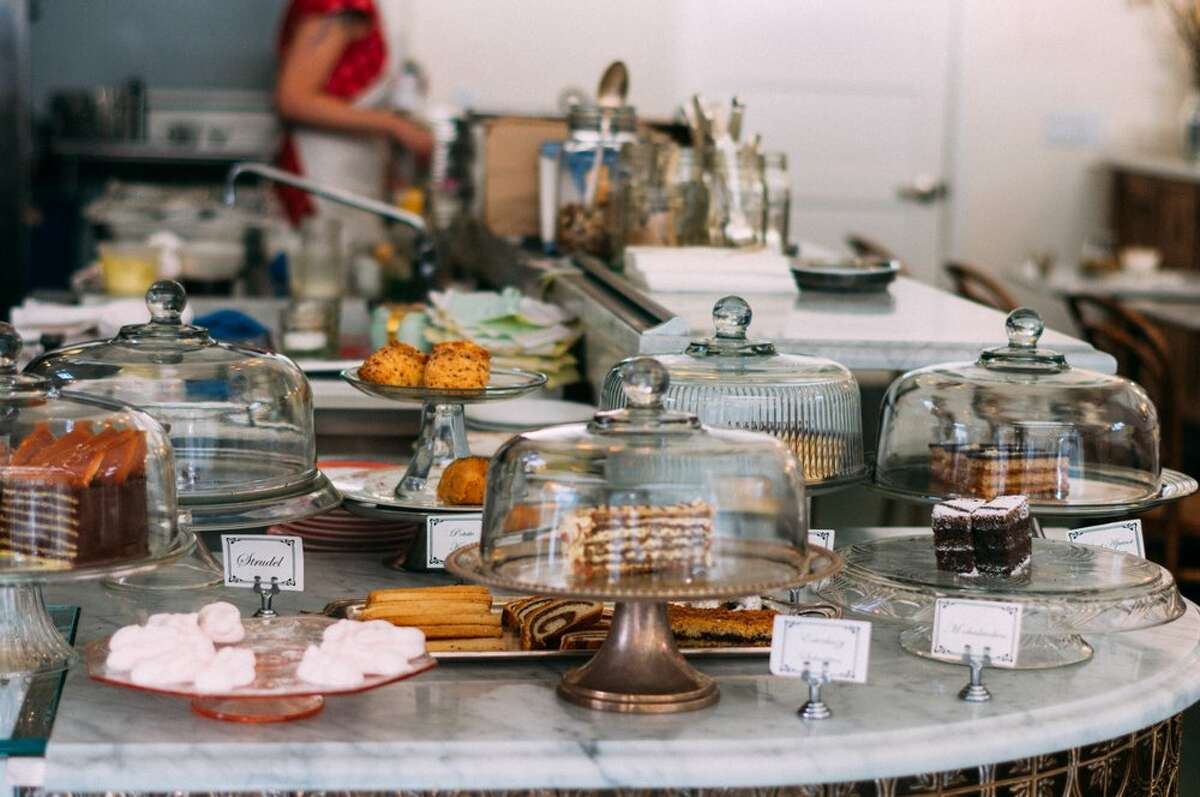 A counter of cakes and pastries at 20th Century Cafe, which is set to close in a few months.