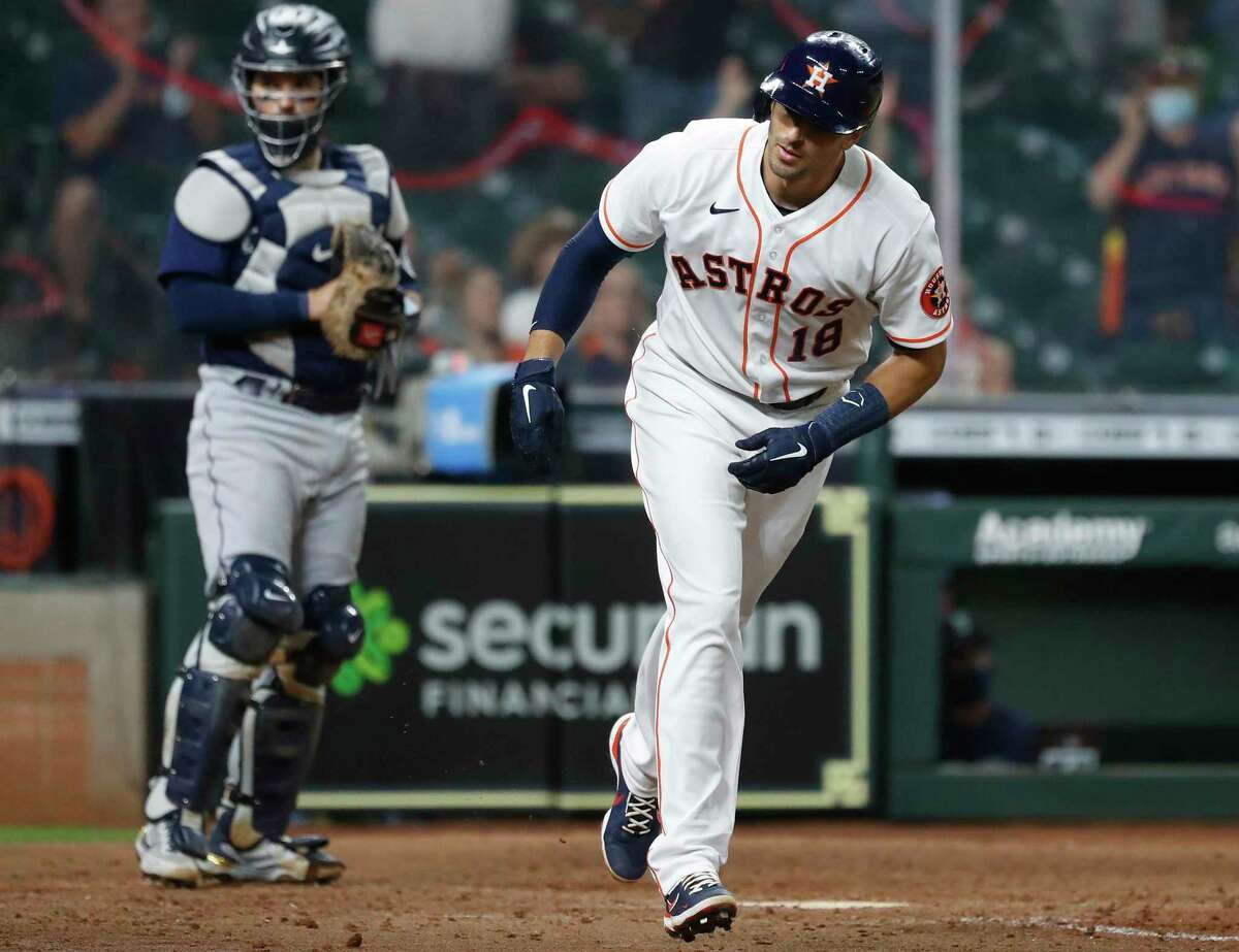 Jason Castro took a pleasant walk during the Astros' eighth-inning comeback Wednesday night, forcing home the go-ahead run in a 7-5 victory over the Mariners at Minute Maid Park.